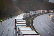 Freight Lorries line up in queues contained in operation Stack on the M20 motorway at Ashford, Kent, United Kingdom on the 23rd of December 2020. Truck drivers have been waiting in operation stack on the M20 motorway for over 48 hours now, France closed it's boarders with the UK after a new faster spreading strain of the COVID-19 virus broke out in Kent. <br /> (photo by Andrew Aitchison / In pictures via Getty Images)
