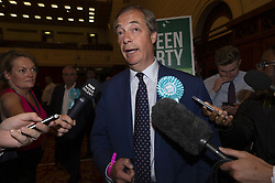 May 27, 2019, Southampton, Britain, UK: British Brexit Party leader Nigel Farage is interviewed by the media in a European Parliament elections count centre in Southampton, Britain, on May 27, 2019. The first local results announced Sunday night showed that the Brexit Party outperformed the ruling Conservative and Opposition Labor parties in Britain in the European Parliament elections. (Credit Image: © Ray Tang/Xinhua via ZUMA Wire)