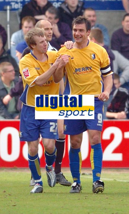 Photo: Leigh Quinnell.<br /> Mansfield Town v Carlisle United. Coca Cola League 2. 22/04/2006. Mansfields Lawrence Wilson(L) congratulates Richard Barker on his goal.