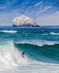 A surfer takes on the big surf at Big Sur California