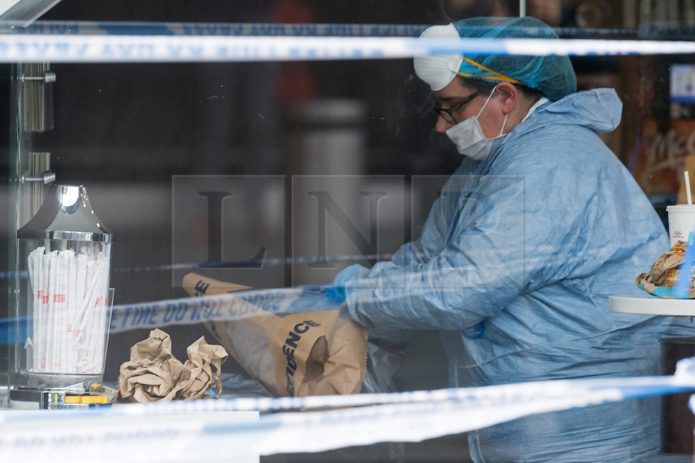 © Licensed to London News Pictures. 15/03/2017. Forensics team gather evidence as police cordon off outside a Macdonald's restaurant in Kings Cross after a man was stabbed outside  restaurant near King's Cross station at 01:15am. Police were called to reports of a stabbing at the junction between York Way and Pentonville Road in Islington at 1.15am. London, UK. Photo credit: Ray Tang/LNP