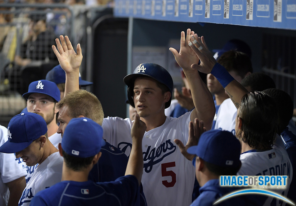 Sep 6, 2016; Los Angeles, CA, USA; Los Angeles Dodgers shortstop Corey Seager (5) is congratulated by teammates after scoring in the first inning against the Arizona Diamondbacks during a MLB game at Dodger Stadium.