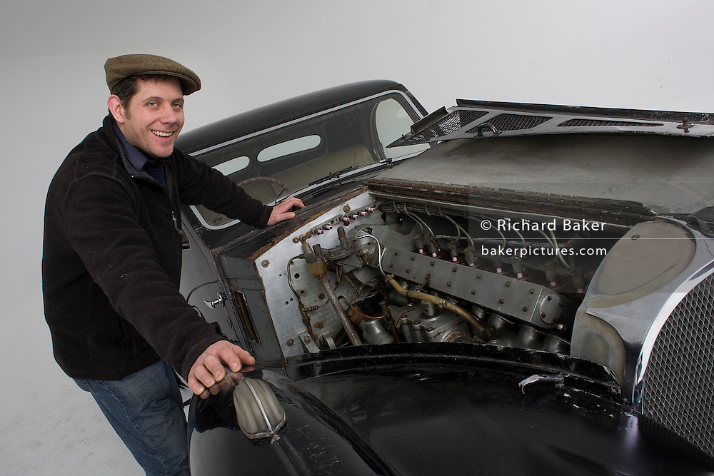 Found in a garage where it had been stored virtually untouched for 50 years, this 1937 Bugatti Type 57s Atalante sports car is previewd for the first time before a Bonhams auction in Paris on February 7th 2009. With an open bonnet is Phoenix Green Garage Studio owner and vintage car restorer Nick Benwell.