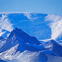 Unnamed summits rise in the Queen Maud Mountains of Antarctica.