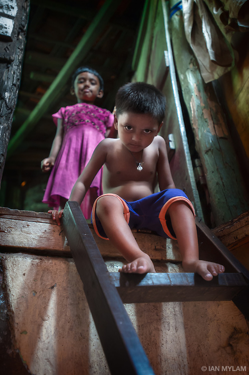 Boy on a Ladder - Dharavi, Mumbai, India