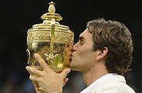 Wimbledon week 2 : Tennis Championships 07/07/2012 Credit Colorsport / Andrew Cowie<br /> Mens singles final Roger Federer v Andy Murray.<br /> Roger Federer kisses the trophy