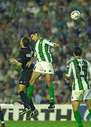 Photo Peter Spurrier<br /> 14/09/2002<br /> 2002 Real Betis vs Real Madrid  - Spanish Liga 1<br /> Betis defender, Juanito Gutiérrez,  out jumps Madrid's, Fernando Morientes Sánchez,