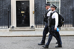 Police Officers in Downing Street, London, as Theresa May's future as Prime Minister and leader of the Conservatives was being openly questioned after her decision to hold a snap election disastrously backfired.