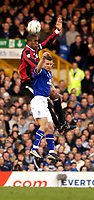 Photo. Jed Wee.<br /> Everton v Manchester City, FA Barclaycard Premiership, Goodison Park, Liverpool. 07/12/03.<br /> Manchester City's Sylvain Distin (L) gets above Everton's Tomasz Radzinski to win the ball.
