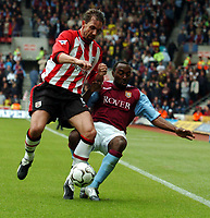 Picture: Henry Browne, Digitalsport<br /> NORWAY ONLY<br /> <br /> Date: 08/05/2004.<br /> Southampton v Aston Villa FA Barclaycard Premiership.<br /> <br /> Claus Lundekvam and Darius Vassell battle it out.