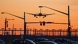 May 4, 2019 - Richmond, British Columbia, Canada - Anarrow-body Airbus jetliner, silhouetted by the setting sun, lands at Vancouver International Airport. (Credit Image: © Bayne Stanley/ZUMA Wire)