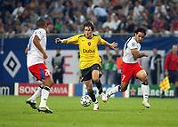 Photo: Chris Ratcliffe.<br /> Hamburg v Arsenal. UEFA Champions League, Group G. 13/09/2006.<br /> Tomas Rosicky of Arsenal clashes with Mehdi Mahdavikia (R) and Nigel De Jong of Hamburg.
