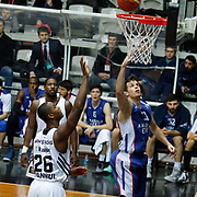 Anadolu Efes's Thomas Heurtel (R) during their Turkish basketball league match Besiktas integral Forex between Anadolu Efes at BJK Akatlar Arena in Istanbul, Turkey, Monday, January 05, 2015. Photo by TURKPIX