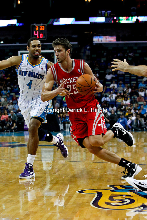 October 24, 2012; New Orleans, LA, USA; Houston Rockets small forward Chandler Parsons (25) drives past New Orleans Hornets shooting guard Xavier Henry (4) during the first quarter of a preseason game at the New Orleans Arena.   Mandatory Credit: Derick E. Hingle-US PRESSWIRE