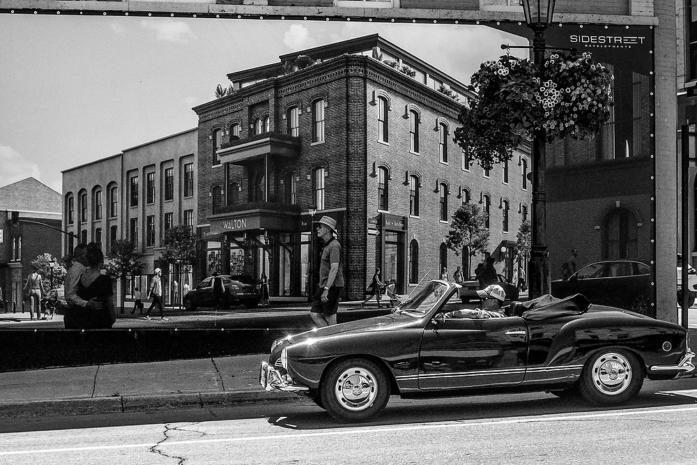 A Carmen Ghia car driving down the mainstreet of Port Hope, Ontario. Street life and documentary photography