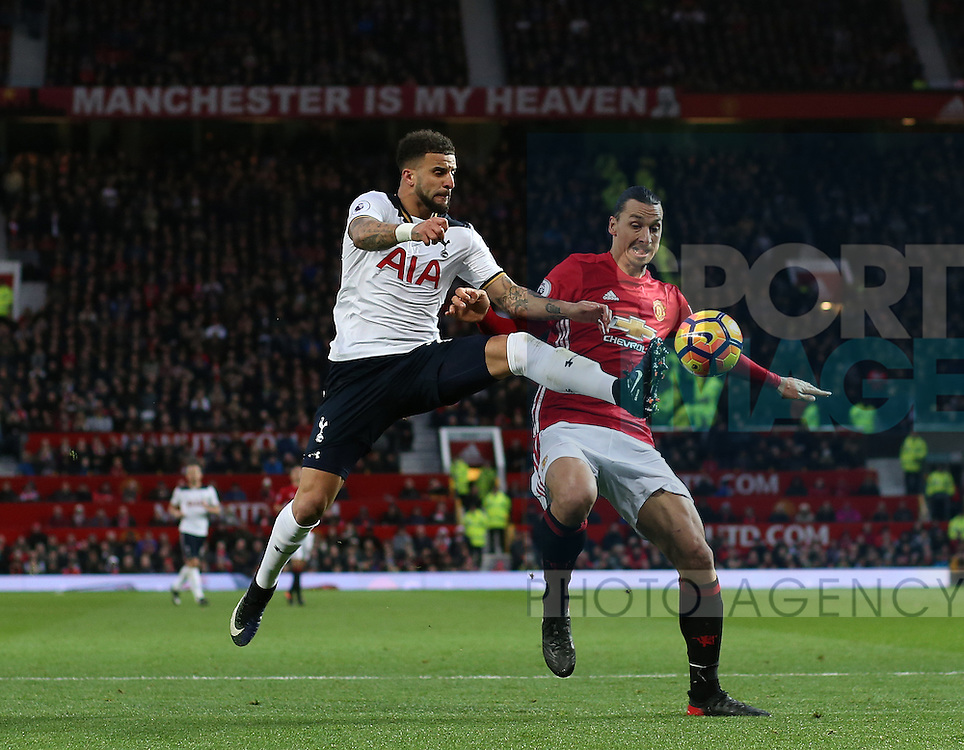 Kyle Walker of Tottenham tussles with Zlatan Ibrahimovic of Manchester United during the English Premier League match at Old Trafford Stadium, Manchester. Picture date: December 11th, 2016. Pic Simon Bellis/Sportimage