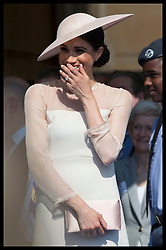 May 22, 2018 - London, London, United Kingdom - Image licensed to i-Images Picture Agency. 22/05/2018. London, United Kingdom. The Duchess of Sussex  gets the giggles as the Duke of Sussex gives a speech at the Prince of Wales' 70th Birthday Patronage Celebration in the gardens of  Buckingham Palace in London. (Credit Image: © Stephen Lock/i-Images via ZUMA Press)