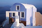 Oia, Santorini Island, Greece: a blue house looks out to the Aegean Sea.