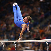 Eddie Penev, Penfield, New York, in action on the Parallel bars during the Senior Men Competition at The 2013 P&G Gymnastics Championships, USA Gymnastics' National Championships at the XL, Centre, Hartford, Connecticut, USA. 16th August 2013. Photo Tim Clayton