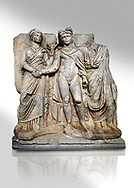 """Roman Sebasteion relief sculpture of emperor Claudius and Agrippina, Aphrodisias Museum, Aphrodisias, Turkey.   Against a white background.<br /> <br /> Claudius in heroic nudity and military cloak shakes hands with his wife Agrippina and is crowned by the Roman people or the Senate wearing a toga. The subject is imperial concord with the traditional Roman state. Agrippina holds ears of wheat: like Demeter goddess of fertility. The emperor is crowned with an oak wreath, the Corona civica or """"citizen crow"""", awarded to Roman leaders for saving citizens lives: the emperor id therefore represented as saviour of the people. .<br /> <br /> If you prefer to buy from our ALAMY STOCK LIBRARY page at https://www.alamy.com/portfolio/paul-williams-funkystock/greco-roman-sculptures.html . Type -    Aphrodisias     - into LOWER SEARCH WITHIN GALLERY box - Refine search by adding a subject, place, background colour, museum etc.<br /> <br /> Visit our ROMAN WORLD PHOTO COLLECTIONS for more photos to download or buy as wall art prints https://funkystock.photoshelter.com/gallery-collection/The-Romans-Art-Artefacts-Antiquities-Historic-Sites-Pictures-Images/C0000r2uLJJo9_s0"""