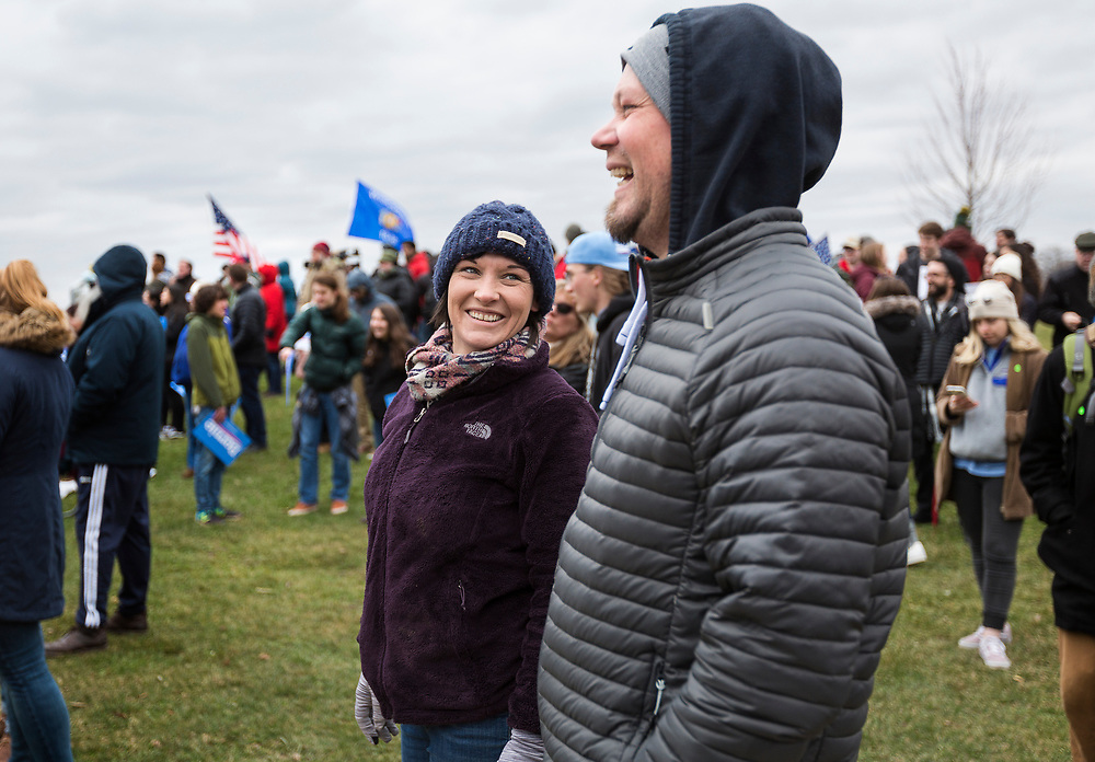 Supporters talk before the rally for Democratic 2020 presidential candidate Bernie Sanders at James Madison Park in Madison, WI on Friday, April 12, 2019.