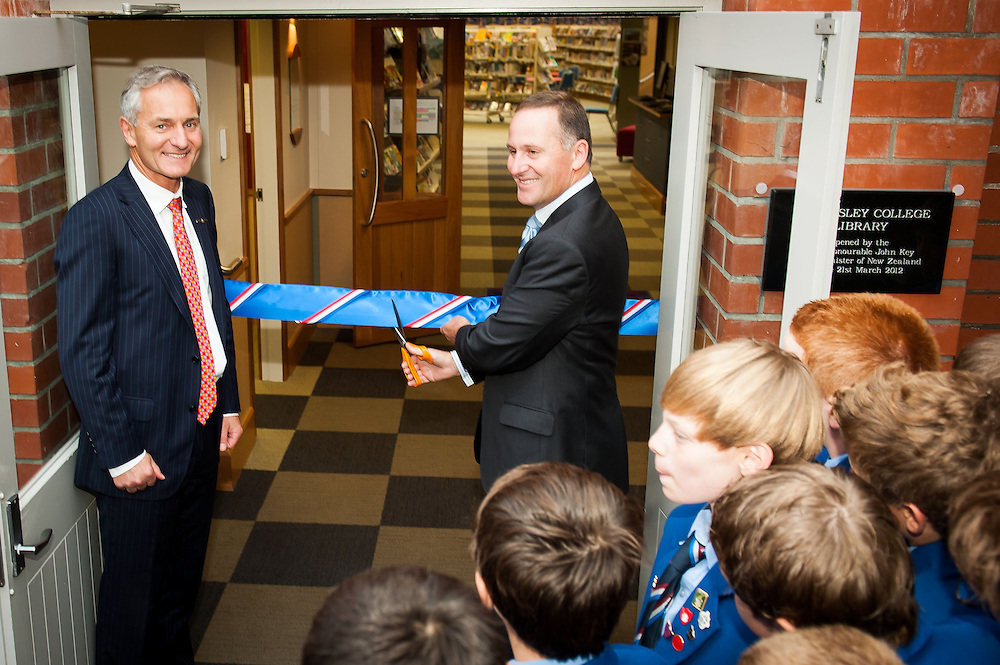 The Rt. Hon. John Key, cuts the ribbon to the Wellesley College library with Principal Warren Owen as students gather around to watch. Wednesday 21st March 2012...Photo by Mark Tantrum | www.marktantrum.com