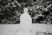 Snow man in Kings Heath during heavy snow fall and build snow men on Sunday 10th December 2017 in Birmingham, United Kingdom. Deep snow arrived in much of the UK, closing roads and making driving treacherous, while many people simply enjoyed the weather.
