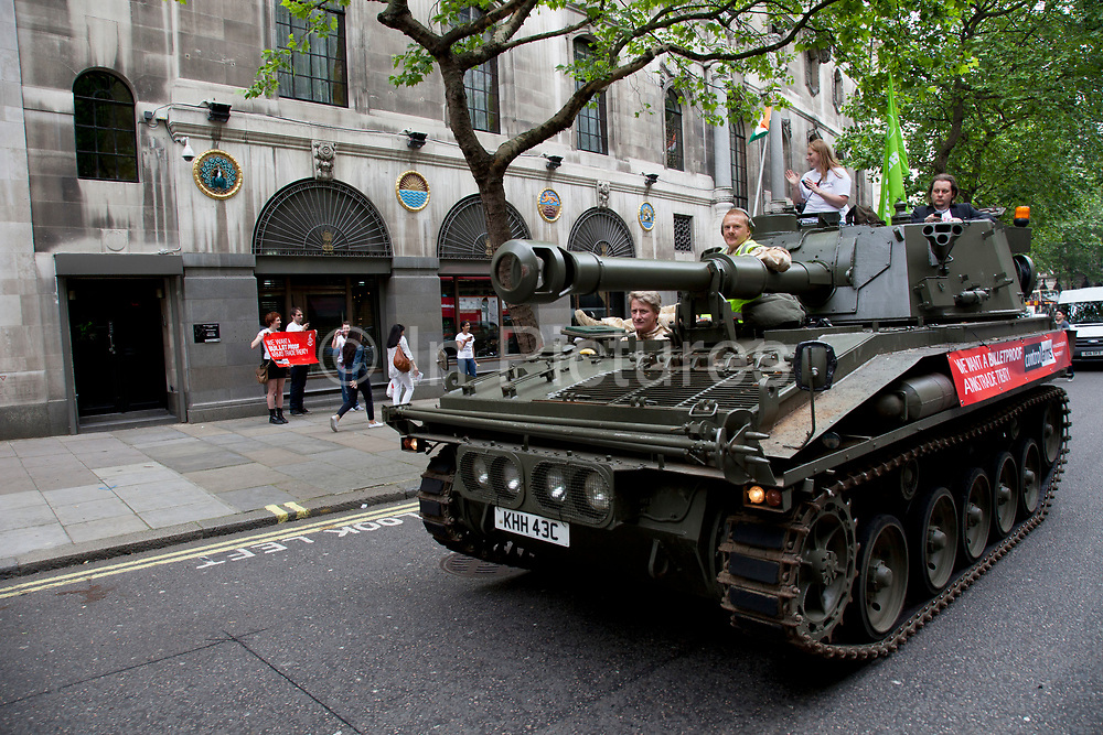Tank passing the High Commision of India. Campaigners and supporters from Oxfam and Amnesty International, as part of the Control Arms coalition, drive an Abbot gun tank around central London to highlight the need for a global Arms Trade Treaty (ATT) to be agreed during a United Nations conference next month (July 2012). London, England, UK. 27th June 2012.