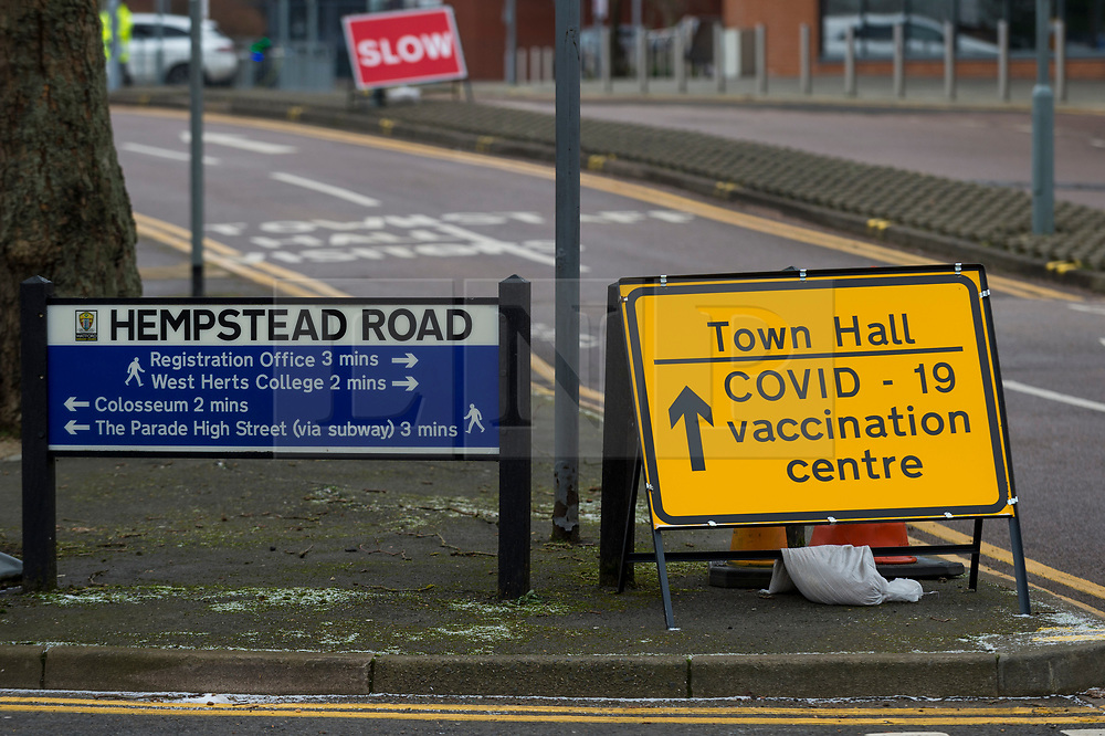 © Licensed to London News Pictures. 11/02/2021. WATFORD, UK. A sign directing patients to a new Covid-19 vaccine centre at Watford Town Hall.  Watford Borough Council has worked closely with the NHS, to adapt the one level extension to the Town Hall for its new role.  Vaccines are administered on an appointment only basis as the UK government attempts to reach its target of 15 million vaccines administered by 15 February. Photo credit: Stephen Chung/LNP