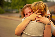 From left: Carla Bledsoe embraces her sister Sherry Bledsoe outside the Shasta County Sheriff's Department, Saturday, July 28, 2018, in Redding, Calif. Sherry's two children Emily Roberts, 5, James Roberts, 4, and her grandmother Melody Bledsoe, 70, died as they attempted to escape the Carr Fire along Quartz Hill Road.