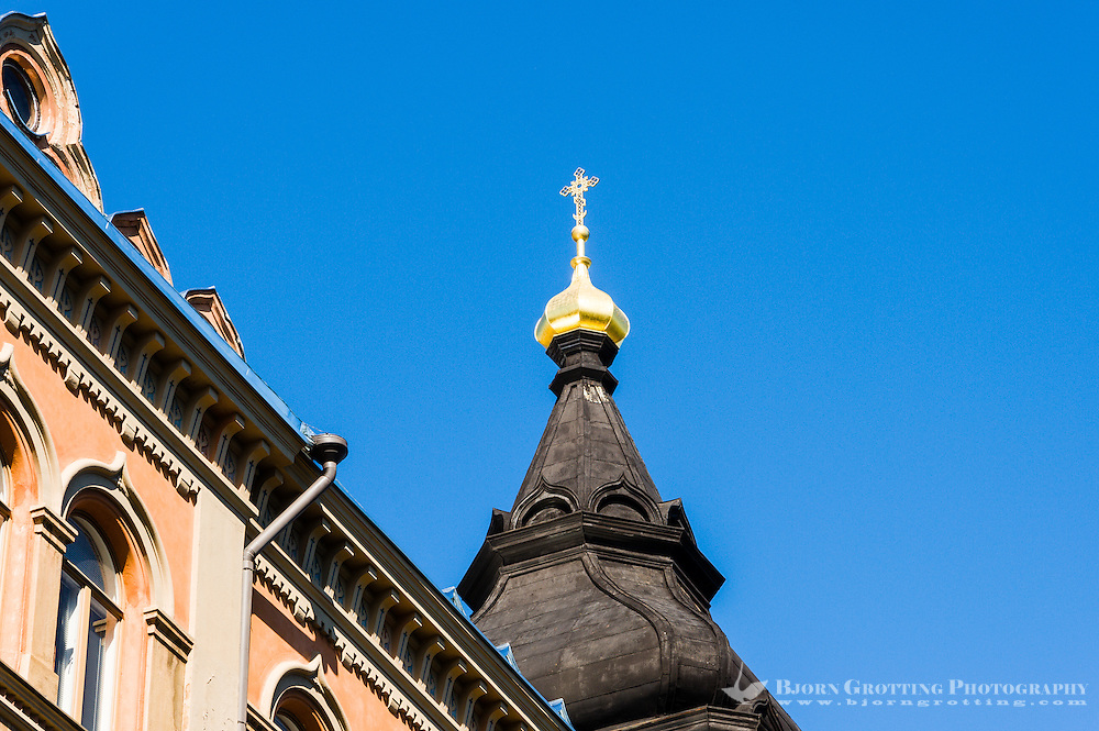 Finland, Helsinki. Old building with spire.