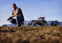 Grampians farmer Graeme Delahunty, his wife Deanne and son 16 year old  James are beside the tractor. James has had to leave school to help Graeme recover the farm from bush fires while he is being treated for cancer.  Pic By Craig Sillitoe SPECIALX 000 melbourne photographers, commercial photographers, industrial photographers, corporate photographer, architectural photographers, This photograph can be used for non commercial uses with attribution. Credit: Craig Sillitoe Photography / http://www.csillitoe.com<br /> <br /> It is protected under the Creative Commons Attribution-NonCommercial-ShareAlike 4.0 International License. To view a copy of this license, visit http://creativecommons.org/licenses/by-nc-sa/4.0/.