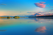 Clouds and Mackenzie Mountains at sunrise reflecting in the Liard River <br /> Near Nahanni Butte<br /> Northwest Territories<br /> Canada