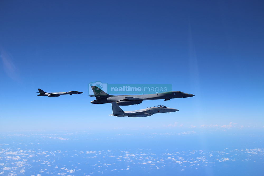 August 16, 2017 - Senkaku Islands, Japan - Two U.S. Air Force B-1B Lancer bombers with the 37th Expeditionary Bomb Squadron is escorted by a Japan Air Self-Defense Force F-15 fighter August 15, 2017 over the Senkaku Islands, Japan. The bomber flying out of Anderson Air Force base on Guam is a show of force as tensions continue with North Korea. (Credit Image: © Usaf/Planet Pix via ZUMA Wire)