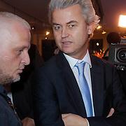 NLD/Amsterdam/20121126- Kika veiling 2012 foto's Veronica gids, Marco Lap in gesprek met Geert Wilders