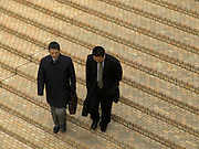 two businessmen descending stairs Asia Tokyo Japan