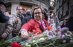 March 28, 2019 - Barcelona, Catalonia, Spain - A woman is seen depositing flowers on the memory plate during the rally..Some 50 people have concentrated to reject the attack on the plaque placed in memory of those tortured by the Francoist repression placed last Monday in front of the old police station of the Spanish police during the Franco regime. (Credit Image: © Paco Freire/SOPA Images via ZUMA Wire)