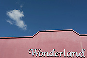 A single fluffy cloud in blue sky passes over Wonderland, a former nightclub in Sutton south London, on 2nd October 2019, in Sutton, London, England
