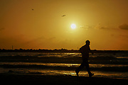 Silhouette of a jogger on the Mediterranean Sea at sunset. Photographed in Tel Aviv, Israel