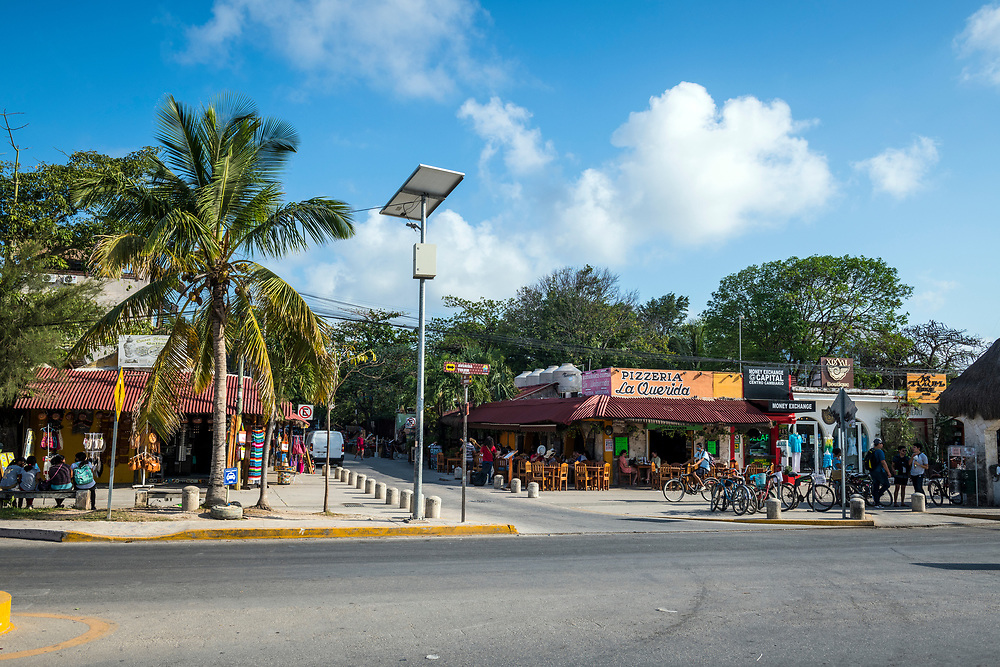 Street scene at the intersection of Avenida Tulum and Calle Centauro Sur in Tulum, Mexico. (April 2021)