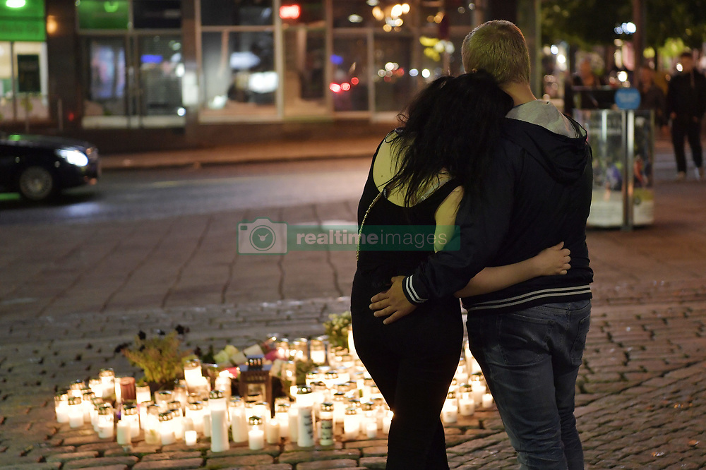 August 19, 2017 - Turku, Finland - People mourning at Salutorget. An 18-year-old Moroccan man is suspected for the stabbing two people to death with a knife and injuring at least six. Police in Finland say a knifeman who killed two people in the south-western city of Turku on Friday appeared to choose women as targets. They are treating the attack as a terrorist incident. (Credit Image: © Bardell Andreas/Aftonbladet/IBL via ZUMA Wire)