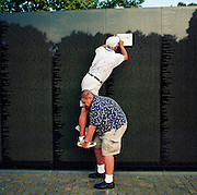 One week after the September 11th attacks in New York and in Washington DC, two ex-US Ranger veterans visit the Vietnam Veterans Memorial in Constitution Gardens, Washington DC. One helps another to climb up to trace the imprint of their dead friend's name, mentioned with 58,195 other recorded casualties on its polished wall. The average age of those men was 19 in the sixties and seventies. The nation was mourning those killed in the New York and Washington attacks, and the military was about to mobilise once again with many American lives lost. The Vietnam war however, remains a low-point in the nation's history and the old men who survived return to 'find' their buddies which helps them deal with the traumatic loss of their friends and their own youth..