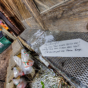 Neighbors at odds with each other over dog droppings left in an alley in the Crossroads District in Kansas City, Missouri.