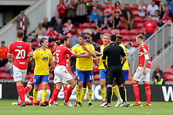Middlesbrough's George Friend and Birmingham City's Lukas Jutkiewicz calm the situation after Craig Gardner is sent off