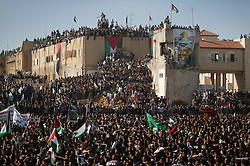 Palestinians wait for the delivery of leader Yasser Arafat's body so he can be buried at his compound, Ramallah, Palestinian Territories, Nov. 12, 2004. Arafat died in a Paris hospital at the age of 75.
