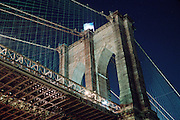 The Brooklyn Bridge shot from the side at night
