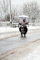 Brave or foolish biker on the A6135 Ecclesfield Rd, Chapeltown Sheffield,  during the most widespread Snows to hit Britain for 20 years.1st December 2010.Images © Paul David Drabble