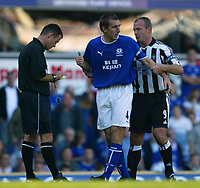 Photo Aidan Ellis.<br />Everton v Newcastle United.<br />FA Barclaycard Premiership.<br />13/09/2003.<br />Referee Mr R Styles makes another booking Alan Stubbs of Everton whilst Alan Shearer trys to pull him away