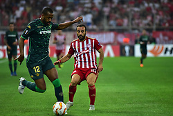 September 20, 2018 - Piraeus, Attiki, Greece - Sidnei (no12) of Real Betis tries to avoid Giannis Fetfatzidis (no 10) of Olympiacos. (Credit Image: © Dimitrios Karvountzis/Pacific Press via ZUMA Wire)