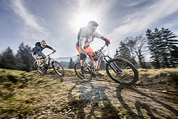 Mountain bikers speeding on dirt path, Bavaria, Germany
